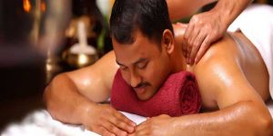 A Man experienced an oil massage by professional massage therapists.