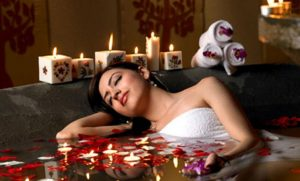 A Woman Experienced a soothing massage therapy in the leading massage center.